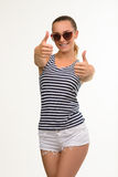 Pretty exited girl giving thumbs-up. Stock Photo