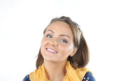 Pretty expressive lady wearing a polka dots dress white sunglasses and yellow scarf in the studio Royalty Free Stock Photo