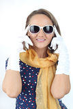 Pretty expressive lady wearing a polka dots dress white sunglasses and yellow scarf in the studio Stock Photo