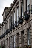Facade of Edinburgh Town Houses showing ornate balustrades. Pretty facade of Edinburgh Town Houses showing ornate balustrades stock photo