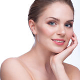 Pretty face of beautiful smiling woman - posing at studio isolated on white Stock Photos