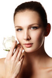 Pretty face of beautiful young woman with rose on hands - white Royalty Free Stock Photography