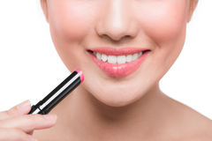Pretty face beauty lady applying lipstick. Beautiful girl makes Royalty Free Stock Photos