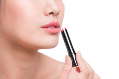Pretty face beauty lady applying lipstick. Beautiful girl makes. Makeup Stock Images