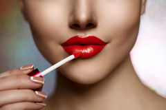 Pretty face beauty lady Red woman lips close up. Beautiful model. Girl with lipstick. Products Treatment. She gets gloss stock photography