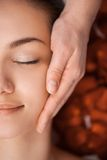 Pretty face massage at the spa salon. Stock Photo