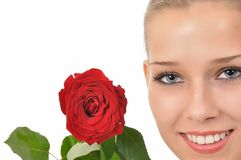 Pretty face with a red rose. Pretty face with blue eyes and a red rose Royalty Free Stock Images
