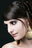 Pretty Face of a Young Woman with Big Earrings Stock Photography