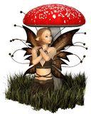 Pretty Fairy Sheltering Under a Toadstool Royalty Free Stock Photography