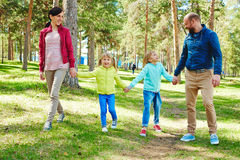 Pretty family having walk in park Royalty Free Stock Image