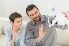 Pretty family is playing with a small drone stock image