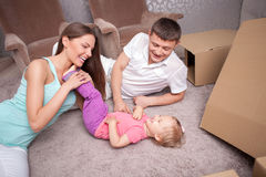 Pretty family is preparing to move in another Stock Image