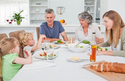 Pretty family at the table together Royalty Free Stock Photography