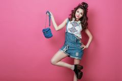 Pretty fashion cool smiling girl with headphones knitted bag sunglasses wearing a colorful clothes with curly hair dancing happy o. Pretty fashion cool smiling Stock Photo