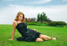 Pretty fashion girl. On green grass Stock Photography