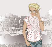 Pretty fashion girl on a city background Royalty Free Stock Image