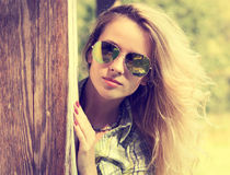 Pretty Fashion Hipster Girl in Glasses Peeking Stock Photos