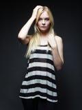 Pretty fashion model on grey background Royalty Free Stock Photography