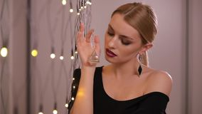 Pretty fashion model plays with electric garland, slow motion. Pretty fashion model plays with yellow electric garland, slow motion stock video