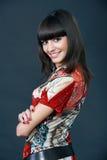Pretty fashion model posing on a dark background. In a studio Stock Image