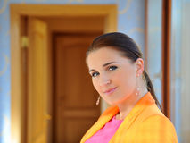 Pretty fashion woman in bright clothes indoors Royalty Free Stock Photo