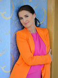 Pretty fashion woman in bright clothes indoors Royalty Free Stock Photos