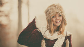 Pretty fashion woman in fur winter hat. Stock Photos