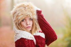 Pretty fashion woman in fur winter hat. Stock Photo