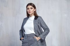 Pretty fashion woman wear wool coat jacket casual trend clothes collection catalogue brunette hair party style model pose. Bright make-up beautiful face dress stock photo