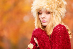 Pretty fashion woman in winter hat feeling cold. Stock Image