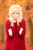 Pretty fashion woman in winter hat feeling cold. Stock Photos