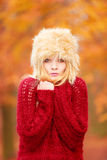 Pretty fashion woman in winter hat feeling cold. Royalty Free Stock Photo