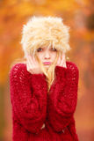 Pretty fashion woman in winter hat feeling cold. Stock Images