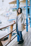 Pretty fashion young woman posing in a dock Royalty Free Stock Image