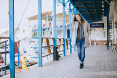 Pretty fashion young woman posing in a dock Stock Photo