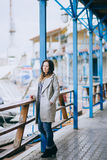 Pretty fashion young woman posing in a dock Royalty Free Stock Photography