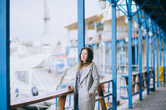 Pretty fashion young woman posing in a dock Stock Images