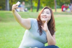 Pretty fat female takes travel selfie Royalty Free Stock Photos