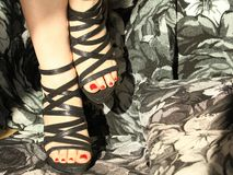Pretty feet with black sandals Royalty Free Stock Photography