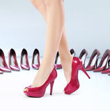 Pretty feets on the high-heel shoes Stock Photo