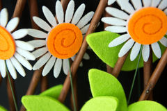 Colorful felt daisy flowers. Closeup of pretty, colorful daisy flowers made of felt fabric Royalty Free Stock Image