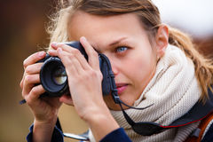 Pretty female amateur photographer taking photos Stock Photos