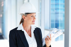 A pretty female architect holding blueprints Royalty Free Stock Images