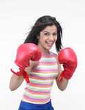 Pretty female asian boxer. Girl of indian origin with red boxing gloves Royalty Free Stock Photos