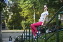 Pretty female athlete resting in the Park. Stock Photo