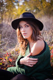 Pretty Female In Black Hat Posing Outdoors On Stock Image