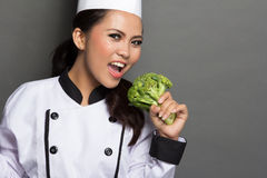 Pretty female chef playing with broccoli Royalty Free Stock Photo