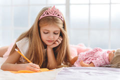 Pretty female child picturing while dreaming Royalty Free Stock Images