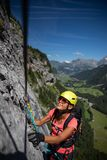 Pretty, female climber on a via ferrata stock image