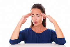 Pretty female with closed eyes suffering headache Stock Photos